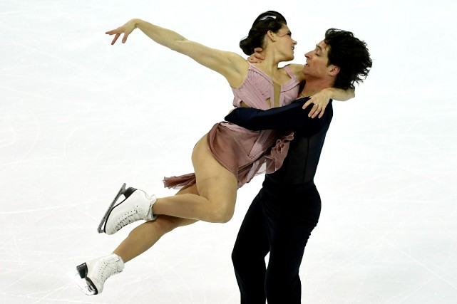Tessa Virtue et Scott Moir... (PHOTO ANNE-CHRISTINE POUJOULAT, AFP)