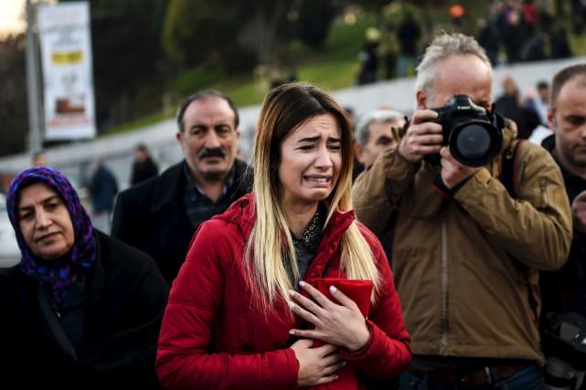 Une proche d'une des 38 victimes du double... (AFP, Bulent Kilic)