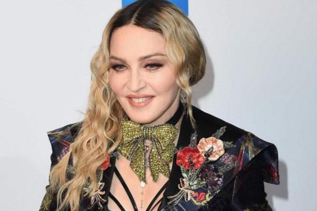 À 58 ans, même une légende de la pop comme Madonna, qui n'a plus rien à prouver... (PHOTO ARCHIVES AFP)