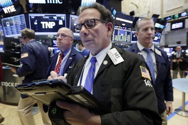 Wall Street a terminé à des niveaux records mardi, bénéficiant toujours des... (Photo Richard Drew, AP)