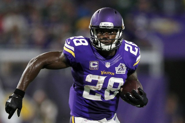 Adrian Peterson a passé ses 10 saisons dans la... (Photo Andy Clayton-King, archives AP)