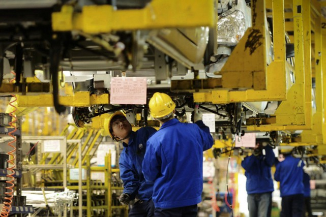 General Motors emploie 58 000 personnes en Chine.... (PHOTO AP)