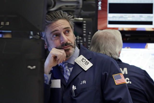 Le Dow Jones prenait 0,18% et le Nasdaq... (AP)