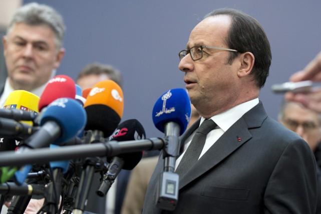 «La Russie prend des engagements qu'elle ne tient... (AP)