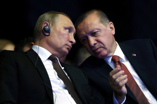 Les présidents russe Vladimir Poutine et turc Recep Tayyip... (PHOTO KAYHAN OZER/TURKISH PRESIDENTIAL PRESS OFFICE via AFP)