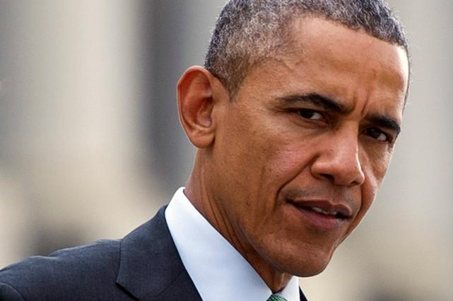 Barack Obama... (PHOTO Cliff Owen, archives AP)