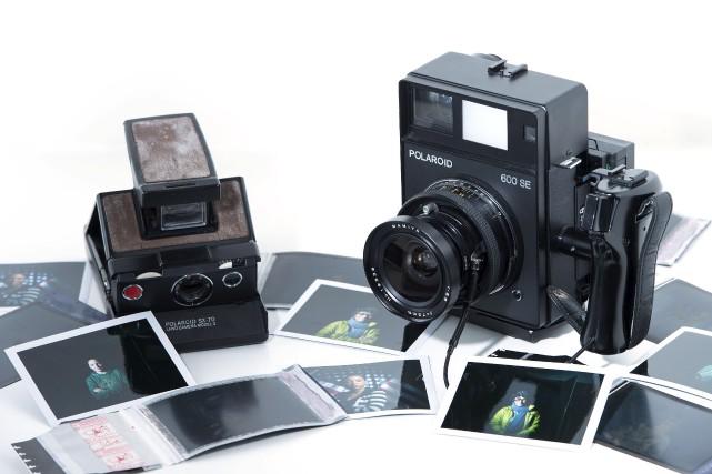 D'anciens appareils de la marque Polaroid se vendent... (AFP)