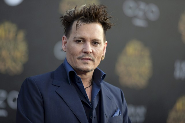 Depp, qui est payé 20millions$ par film, ne... (AP)