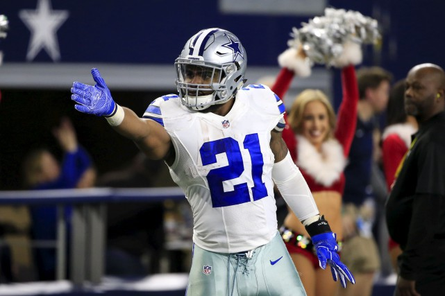 Dallas Cowboys running back Ezekiel Elliott signals first... (Associated Press)