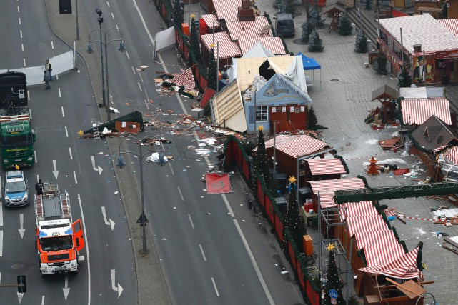 La chancelière allemande Angela Merkel a parlé d'«attentat... (photo Odd ANDERSEN, Agence France-Presse)