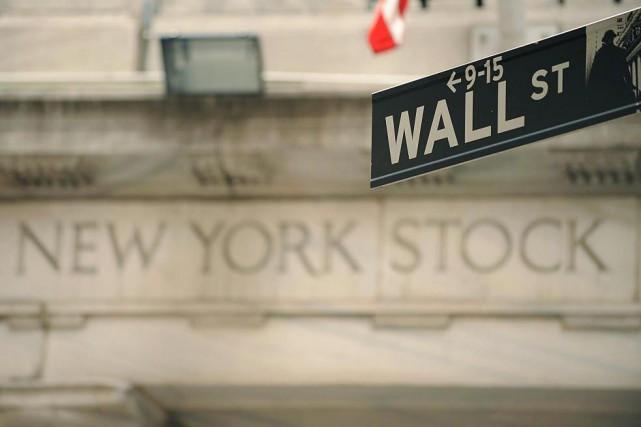 Le Dow Jones prenait 0,29%, comme le Nasdaq,... (PhotoStan HONDA, Archives Agence France-Presse)
