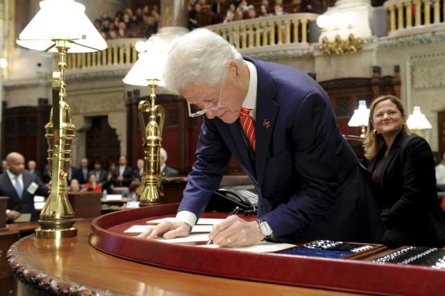 L'ancien président Bill Clinton, grand électeur de l'État... (AP, Hans Pennink)