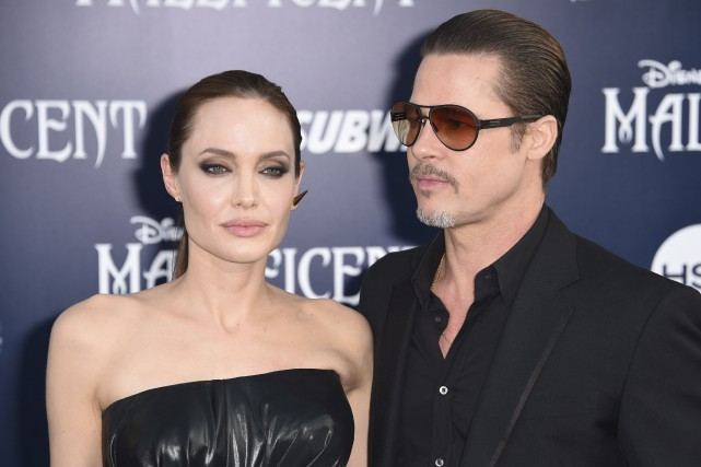 Angelina Jolie et Brad Pitt en 2014. L'acteur... (AFP, Robyn Beck)