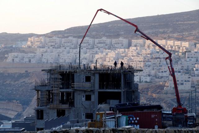 Un site où des logements sont en construction,... (photo Baz Ratner , REUTERS)