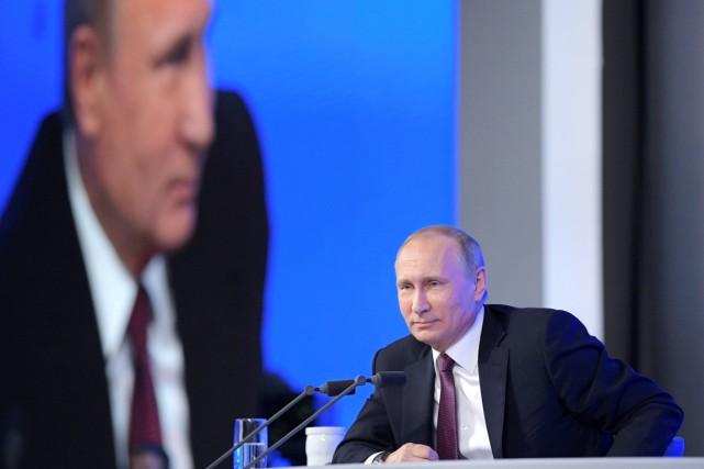 Interrogé au cours de sa traditionnelle conférence de... (photo Alexei Druzhinin, sputnik/REUTERS)