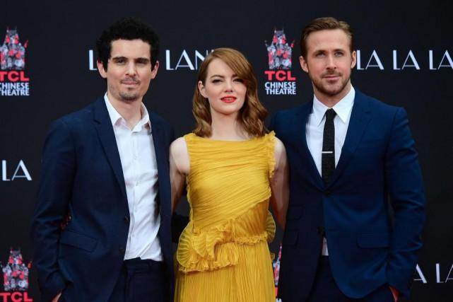 Le réalisateurDamien Chazelle en compagnie des deux acteurs... (PhotoFrederic J. BROWN, Agence France-Presse)