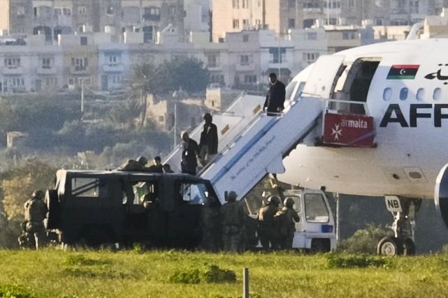Les deux Libyens, qui voulaient obtenir l'asile politique... (AP)