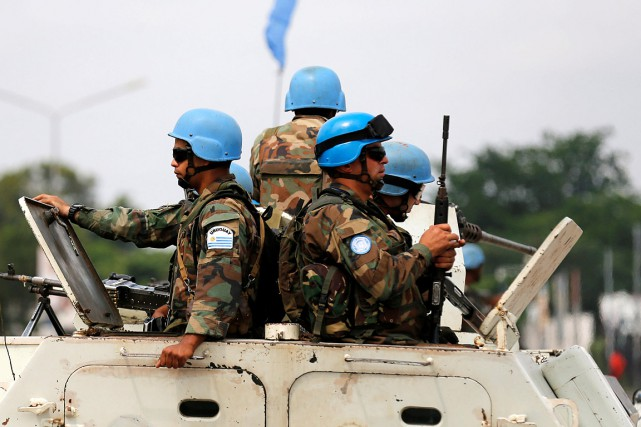Plus de deux ans après les premiers massacres,... (Thomas Mukoya, REUTERS)