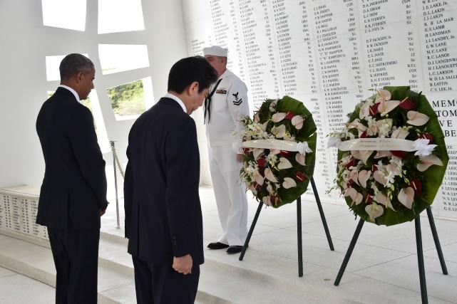 Le président américain Barack Obamaet le premier ministre... (AFP, Nicholas Kamm)