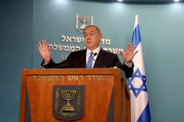Le premier ministre israélien Benyamin Nétanyahou s'est empressé... (PHOTO GALI TIBBON, AFP)
