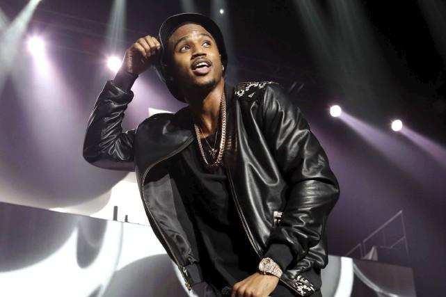 Trey Songz lors d'un spectacle, en mars 2015... (archives Associated Press)