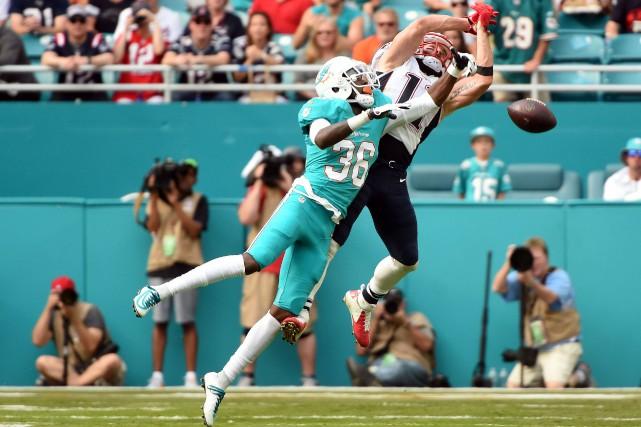 Tom Brady a amassé 276 par la voie des airs et il a lancé trois passes de... (Photo USA Today Sports)