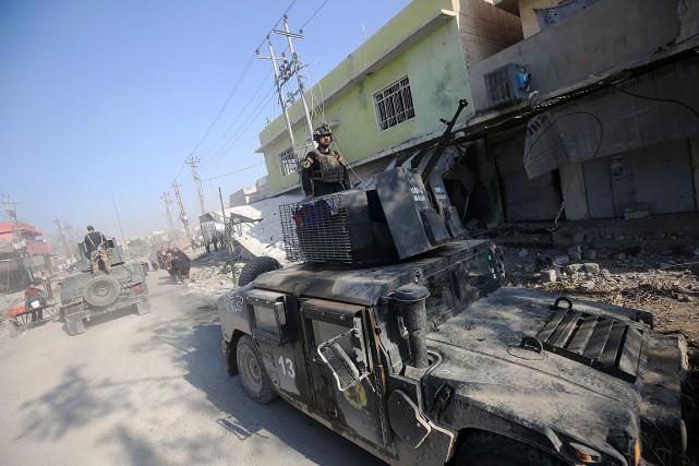 Des forces irakiennes patrouillent à Al-Quds,repris au groupe... (AHMAD AL-RUBAYE, archives AFP)