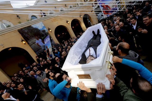 Les corps des victimes étrangères ont été rapatriés... (AFP, Joseph Eid)