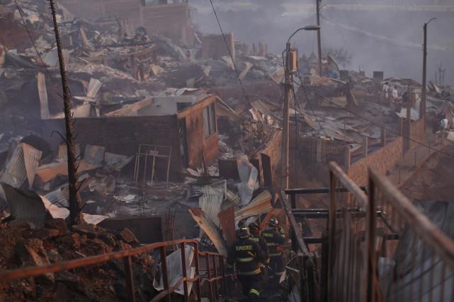 Selon le dernier bilan officiel, environ 150 logements,... (AP, Luis Hidalgo)