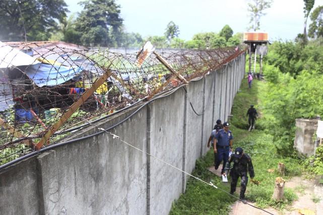 Plusieurs dizaines de prisonniers ont été arrêtés ou... (AP)