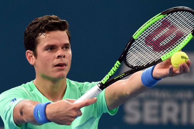 Milos Raonic a réussi 12 as en route... (Saeed Khan, Agence France-Presse)