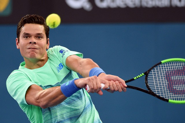 Milos Raonic... (PHOTO Saeed KHAN, AFP)