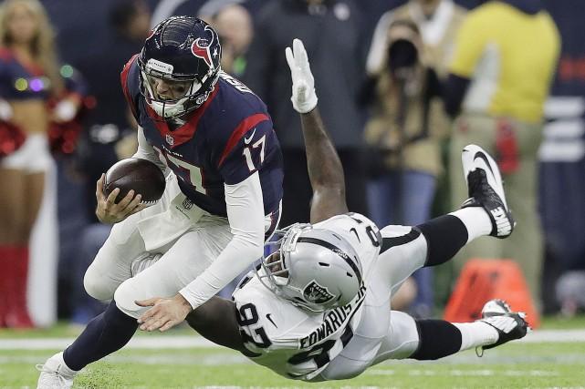 Le quart Brock Osweiler a mené les Texans... (AP, Eric Gay)