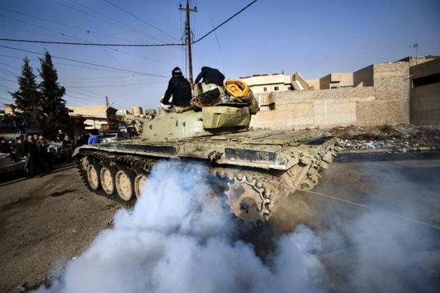 Les forces irakiennes estiment désormais avoir reconquis environ... (PHOTO AFP)