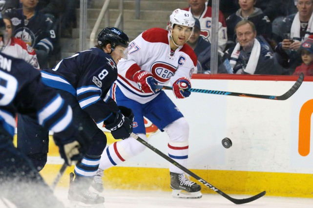 Jacob Trouba et Max Pacioretty... (Photo Bruce Fedyck, USA TODAY Sports)
