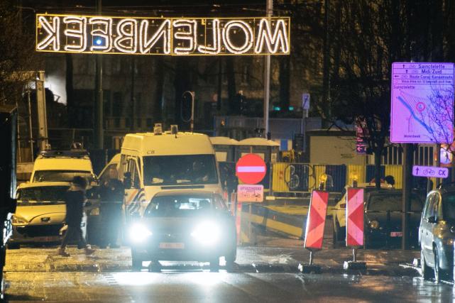 Les enquêteurs ont effectué quatre descentes dans le... (AFP, Belga/FILIP DE SMET)