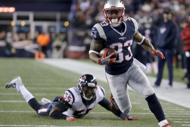 Dion Lewis a capté une passe de touché... (Photo AP)