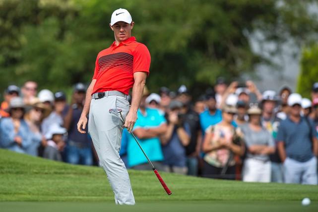 Rory McIlroya ressenti de la douleur au dos... (Archives, AFP)