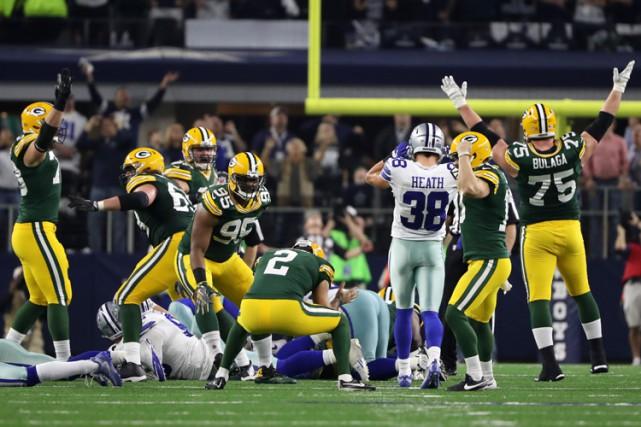 Cette fois, ce fut un attrapé et une autre victoire pour les Packers de Green... (PHOTO REUTERS)