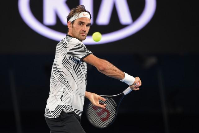 Roger Federer disputait son premier match officiel depuis... (Photo Peter Parks, AFP)