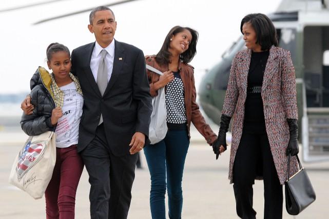 Malia, Barack, Sasha et Michelle Obama.... (PHOTO JEWEL SAMAD, ARCHIVES AGENCE FRANCE-PRESSE)