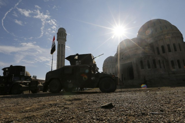 Des dizaines de milliers de forces irakiennes et... (Photo MUHAMMAD HAMED, Reuters)