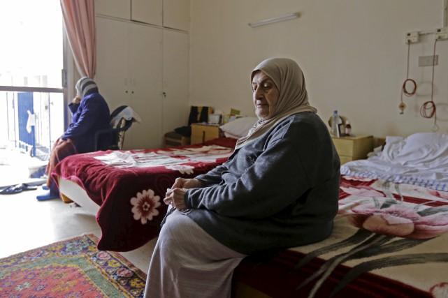 «Je suis venue ici parce que ma maison... (AFP, Louai Beshara)