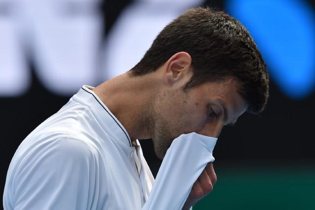 Le sextuple champion des Internationaux d'Australie Novak Djokovic... (Photo Paul Crock, AFP)