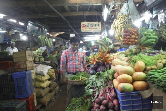 Dans un des marchés publics de Cochin, dans... (Pierre Jury, Le Droit)