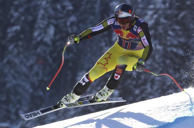 Érik Guay a raté le podium de 0,16... (AP, Alessandro Trovati)