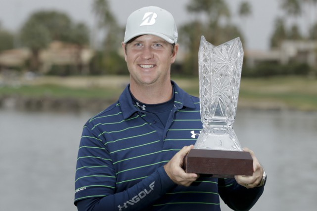 Hudson Swafford poses with the trophy after winning... (AP)