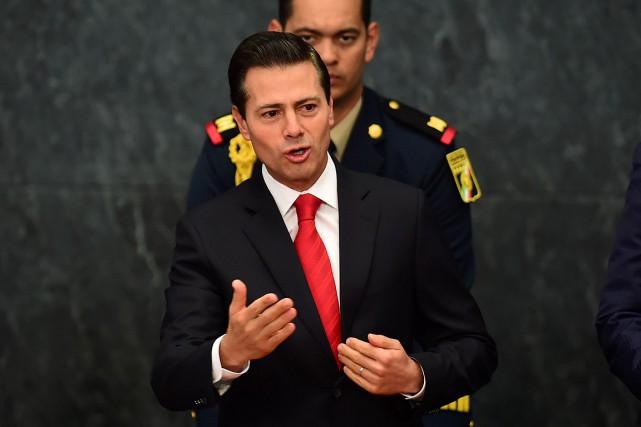 Le président mexicain Enrique Peña Nieto... (Photo Ronaldo SCHEMIDT, AFP)