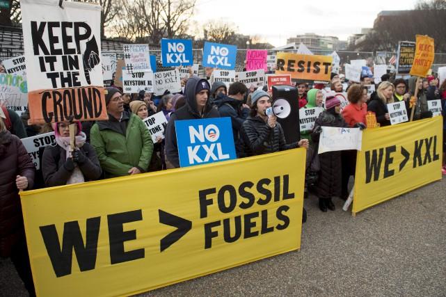 Des opposants au pipeline Keystone XL ont manifesté... (AFP, Saul Loeb)