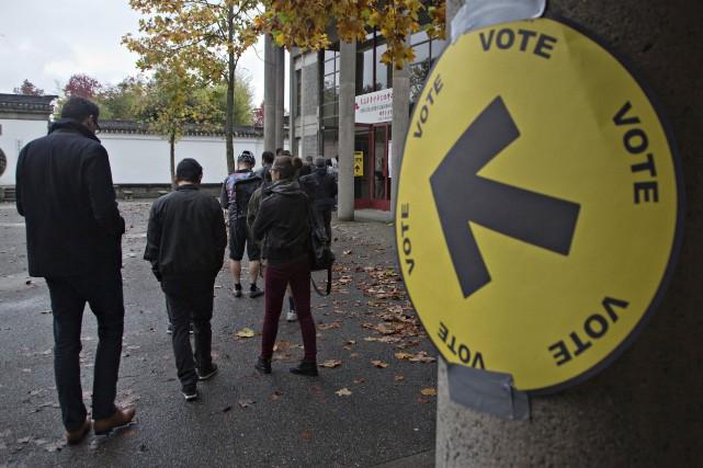 Selon le mode de scrutin préférentiel, les électeurs... (PHOTO Andy Clark, ARCHIVES REUTERS)